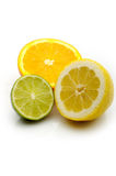 Lemon, Lime and an orange cut. In half citrus on a white stock image