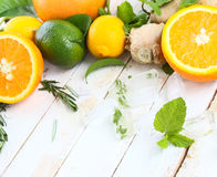 Lemon, lime and orange with mint and rosemary. On a white background royalty free stock photography