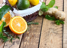 Lemon, lime and orange with mint and rosemary. On a white background stock photo