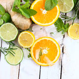 Lemon, lime and orange with mint and rosemary. On a white background royalty free stock image