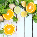 Lemon, lime and orange with mint and rosemary. On a white background stock images