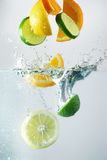 Lemon, lime and orange splash. In clear wather royalty free stock photos