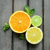Lemon, lime and orange. In a trio figure stock image