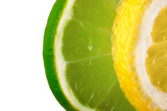 Lemon and lime overlapped slices on white background Stock Photos
