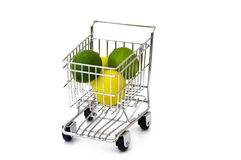 Lemon and lime in shopping cart. Isolated lemon and lime in shopping cart Stock Photos