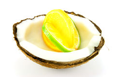 Lemon and Lime Slice in a Coconut. Slice of lemon and lime in a half coconut on a white background Stock Photos
