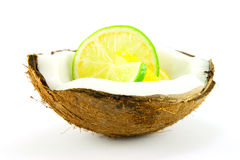 Lemon and Lime Slice in a Coconut. Slice of lemon and lime in a half coconut on a white background Stock Image