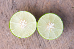 Lemon lime slice put on  wooden Stock Image