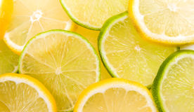 Lemon and lime slices. Abstract background Stock Image