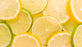 Lemon and lime slices abstract background. Lemon and lime slices (abstract beautiful photo Royalty Free Stock Photos