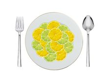 Lemon and lime slices on plate, spoon and fork isolated on white Stock Images