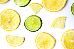 Lemon and lime slices on white Stock Photography