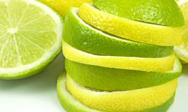 Lemon and lime stack. Close-up of a lemon and lime slices on a stack Stock Photography