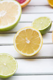 Lemon, lime and sweetie grapefruit on white wood Stock Photos