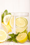 Lemon and lime water drink Stock Images