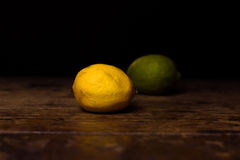 Lemon and lime on wooden surface Stock Photos
