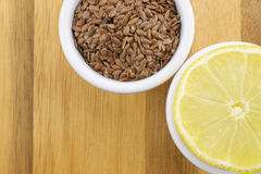 Lemon and linseeds. On wooden background Royalty Free Stock Photography