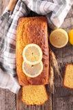 Lemon loaf cake. On wood background stock photos