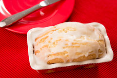 Lemon Loaf And Red Plate. Lemon bread and red plate Stock Photo