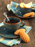 Lemon Madeleine and cup of tea Royalty Free Stock Image