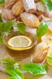 Lemon madeleines with tea Royalty Free Stock Photo