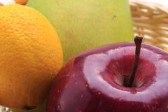 Lemon mango apple in the basket Stock Image