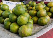 Lemon in the market. Green lemon display on plastic bag in the market Stock Photography