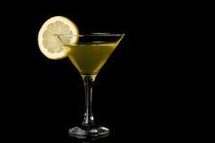 Lemon martini on black background Stock Images
