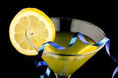 Lemon martini with blue streamer Royalty Free Stock Photos