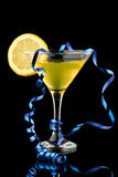 Lemon martini with blue streamer Royalty Free Stock Photography