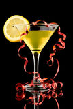 Lemon martini with red streamer Royalty Free Stock Photos