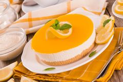 Lemon and mascarpone cheesecake. Lemon and mascarpone cheesecake on white dish stock image