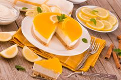 Lemon and mascarpone cheesecake. Lemon and mascarpone cheesecake on white dish royalty free stock image