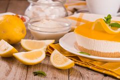 Lemon and mascarpone cheesecake. Lemon and mascarpone cheesecake on white dish royalty free stock photos