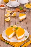Lemon and mascarpone cheesecake. Lemon and mascarpone cheesecake on white dish royalty free stock photography