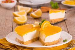 Lemon and mascarpone cheesecake. Lemon and mascarpone cheesecake on white dish royalty free stock images