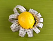 Lemon and measure tape Stock Images