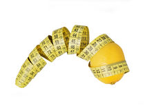 Lemon and measurement. Tape measure. Lemon and measurement. A food and tape measure. Centimeter royalty free stock photography
