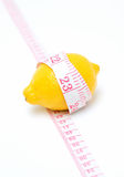 Lemon and measuring tape Royalty Free Stock Photography