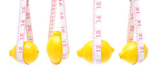 Lemon and measuring tape Stock Image