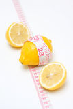 Lemon and measuring tape isolated on white background Stock Images