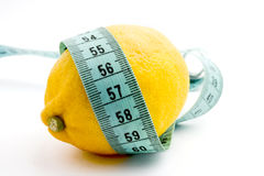 Lemon and measuring tape. Lemon fruit with blue measuring tape Stock Image