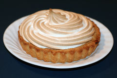 Lemon meringue pie. A perfectly sculpted lemon meringue pie on a white plate Stock Photos