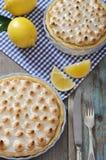 Lemon Meringue Pie. With fresh lemons on checkered background Stock Images