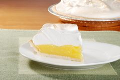 Lemon meringue pie on green placemat. Closeup of a slice lemon meringue pie on green placemat Royalty Free Stock Image