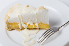 Lemon meringue pie slice with fork Royalty Free Stock Image