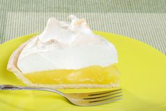Lemon meringue pie slice on plate Stock Photos