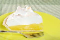 Lemon meringue pie slice on plate Stock Photos