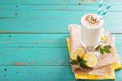 Lemon milkshake with meringue on top Stock Photos