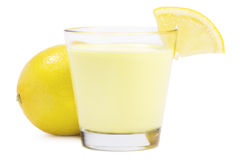 Lemon milkshake with a piece of lemon in front of Royalty Free Stock Photography